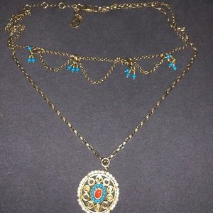 Layered Juicy Couture necklace